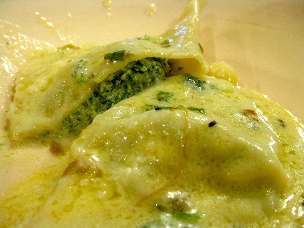 handfolded spinach ricotta ravioli in cream sauce